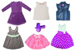 Collage set of little girl summer clothes isolated on a white background. The collection of a sleeveless jeans vest, shoes, short. Summer skirts, shirts and a stock image