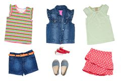 Collage set of little girl summer clothes isolated on a white background. The collection of a sleeveless jeans vest and jeans. Shorts, shoes, short summer skirt royalty free stock photo