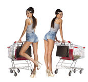 Collage, Smiling women posing next to an empty shopping cart iso Stock Photos