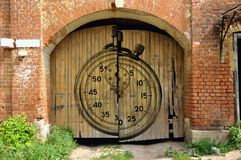 Collage stopwatch and wooden gates. Of the old house Stock Photos