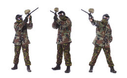 Collage of studio shot of man paintball player. Studio shoots of man paintball player over white background stock image