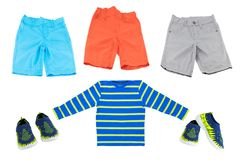 Collage of summer fashion for boys. Bright shorts and shirt. Bl stock images