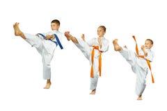 Collage of three athletes beat kick mae-geri Stock Photo