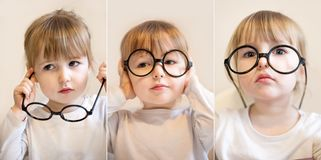 Funny child white girl with big round black teacher glasses on her nose closeup. Collage of three photos with funny child white girl with big round black teacher stock photo