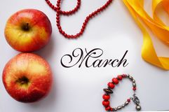 Stylized collage to the international women`s day, March 8 ,. Collage to the international women`s day of apples, yellow ribbon, beads, bracelet. March 8 Stock Photo