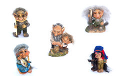 Collage of troll`s figurines on a white background Royalty Free Stock Photography