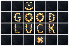 Collage of the uppercase letter - words GOOD LUCK. Alphabet childish colorful homemade cookie isolated on black background Stock Photos