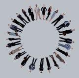 Collage van bedrijfsmensen die zich rond een lege cirkel bevinden Stock Fotografie