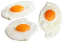Collage van gebraden eieren op wit Stock Afbeelding