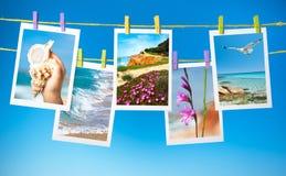 Collage van reisbeelden die op kabels hangen Stock Fotografie
