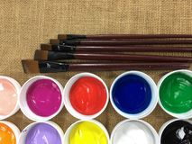Collage of variety of colorful acrylic paints and art brushes Stock Photography