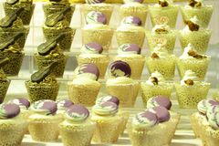 Collage of various cupcakes: vanilla in decorative cup. S Stock Images