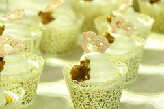 Collage of various cupcakes: vanilla in decorative cup. S Royalty Free Stock Image