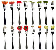 Collage of vegetables in forks Royalty Free Stock Images