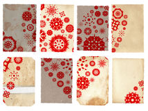 Collage of vintage paper cards. With red snowflake design and detailed texture with copy space Royalty Free Stock Photography