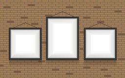 Collage von Bilderrahmen auf der Backsteinmauer Lizenzfreies Stockbild