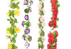 Collage von künstlichen Blumen. Abschluss oben. Lizenzfreies Stockbild