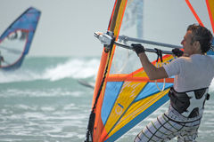 Windsurf men adult in ocean Royalty Free Stock Photo