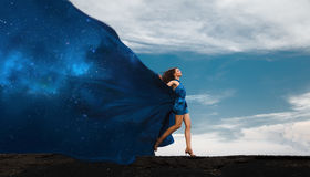 Collage with woman in dress and space dress. Day and night. Collage with woman in dress and space dress. Day and night royalty free stock photography