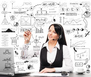 A collage of a woman working in an office and symbols Royalty Free Stock Photography