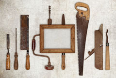 Collage work wood tools carpenter and picture frame. On ruined wall royalty free stock image