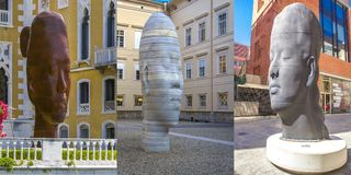 The work of the famous architect and sculptor Jaume Plensa `See my dreams` is the head of a 14-year-old girl with closed eyes. stock photo