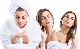 Collage of young woman in bathrobe washing face with clean water. Over white background stock photos