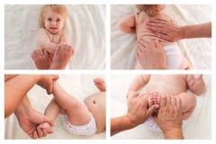 Collagemassören som gör massage, och gymnastik behandla som ett barn lite Royaltyfri Foto