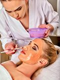 Collagen face mask. Facial skin treatment. Woman receiving cosmetic procedure. Stock Photos