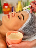 Collagen face mask. Facial skin treatment. Woman receiving cosmetic procedure. royalty free stock images