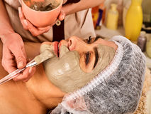 Collagen face mask . Facial skin treatment. Woman receiving cosmetic procedure. Royalty Free Stock Photo