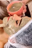 Collagen face mask. Facial skin treatment. Woman receiving cosmetic procedure. Collagen face mask. Facial skin treatment. Face of woman of elderly woman 50-60 stock photography