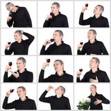 Collagen-Mann, der ein Glas roten Portwein schmeckt Lizenzfreies Stockfoto