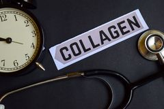Collagen on the print paper with Healthcare Concept Inspiration. alarm clock, Black stethoscope. royalty free stock image