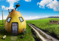 Collages. Pear in the form of a house with a jack and a stork Stock Photo
