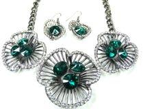 Collana con i cristalli luminosi gioielli ed orecchini Fotografie Stock