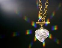 Collana dell'oro con un cuore Fotografie Stock Libere da Diritti