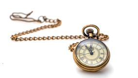 Collana dell'orologio su fondo bianco fotografia stock