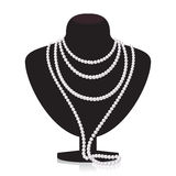 Collana della perla sul mannequin nero illustrazione vettoriale
