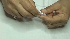 Collana delle perle dentellare video d archivio