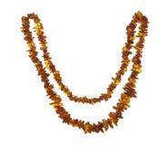 Collana di ambra isolata su fondo bianco Fotografia Stock