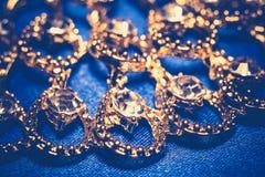 Collana dorata su fondo blu retro Immagine Stock Libera da Diritti