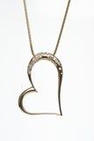 Collana a forma di del cuore dorato Immagini Stock Libere da Diritti