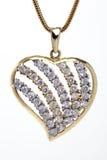 Collana a forma di del cuore dorato con le pietre Fotografia Stock