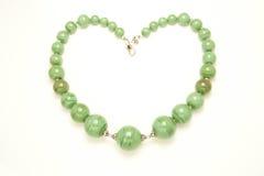 Collana verde a forma di del cuore Fotografie Stock Libere da Diritti