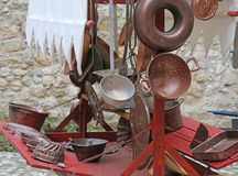 Collander and other old copper objects in cart for sale at flea Royalty Free Stock Image