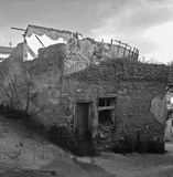 Collapse. A collapsed bulding with great shadows in an old village. A black and white scene witch expressing disaster Royalty Free Stock Photos