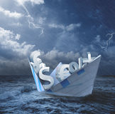 Collapse of economy concept. With money symbols on the boat Royalty Free Stock Image