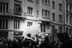 We Collapse palcard at nationwide protest in France stock photo