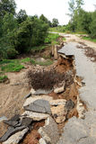 Collapse of the paved road in the forest Stock Photos